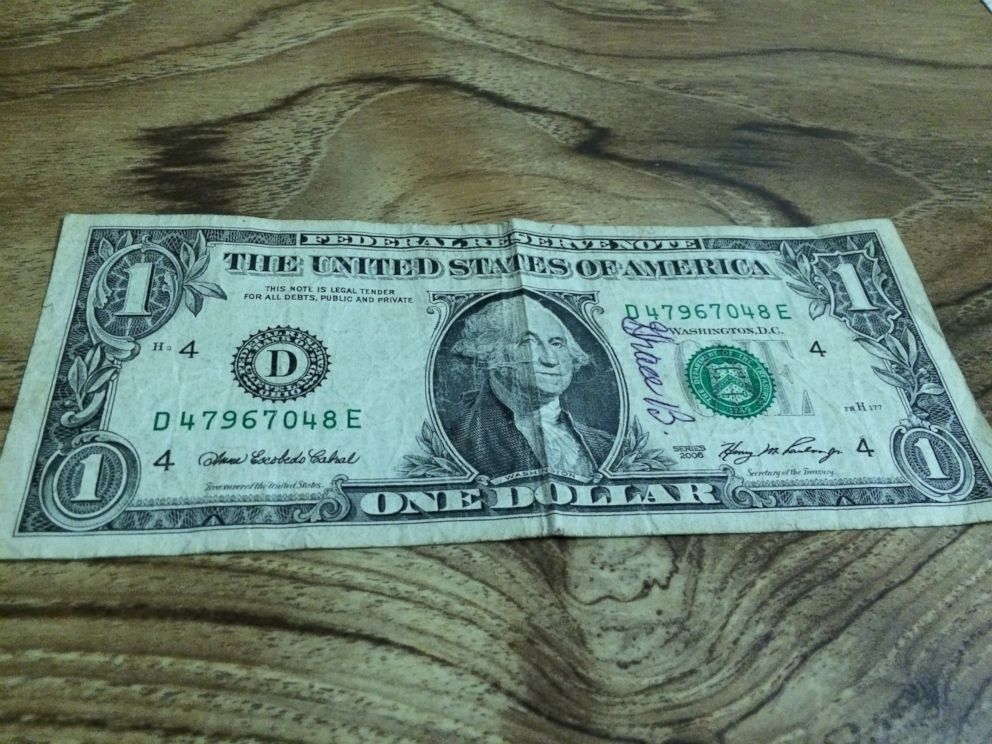PHOTO: Peter Bilello, a widow, accidentally spent this dollar bill signed by his wife Grace. Years later, he got the bill back.