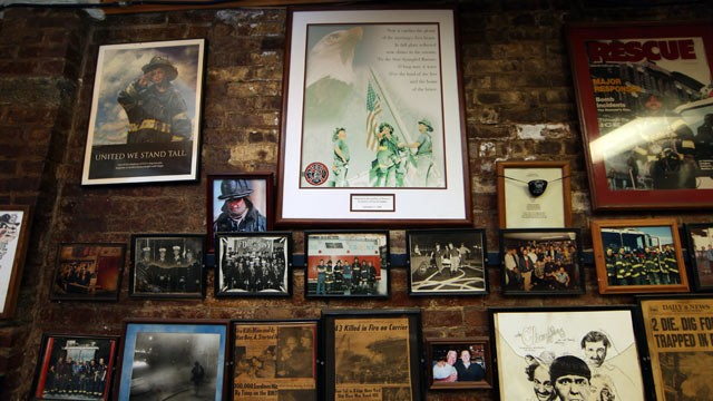 PHOTO: A plaque featuring the famous photograph of three firefighters hoisting a flag out of debris, in Sept. 11, 2001, hangs on the wall of Rescue Company 2, in Brooklyn, New York, where one of the men in the photo still works as a firefighter.