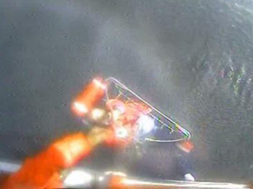 PHOTO: An MH-65 Dolphin helicopter crew from Coast Guard Air Station Port Angeles hoists a man from his life raft after he abandoned his 25-foot pleasure craft Dawn Trader following an engine fire three miles north of Neah Bay, Wash. on Aug. 3, 2014.