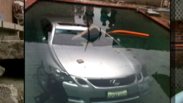 PHOTO: The Diaz family woke up on May 13, 2012 to find that a Lexus had crashed through their backyard and landed in their pool overnight in La Puente, Califronia.