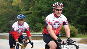 PHOTO Parkinsons patient, Chris Woods, right, rides in a 100 mile New England Parkinson?s Ride.