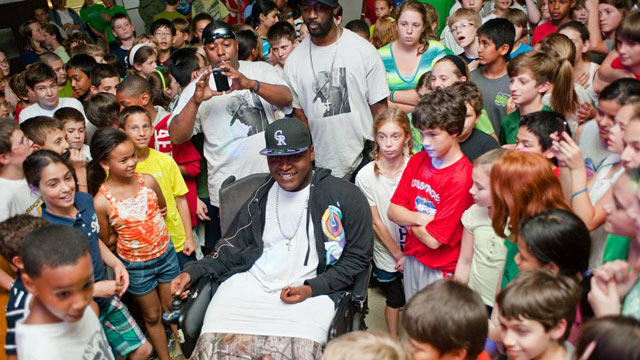 PHOTO: Darius Weems, an aspiring rapper who suffers from Duchenne Muscular Dystrophy, is surrounded by fans at the Jamesville Dewitt Middle School in Syracuse, N.Y.