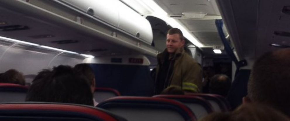 PHOTO: A passenger tweeted this photo of a firefighter while onboard Delta flight 689 on March 16, 2016. The flight was delayed after an electronic cigarette ignited in a passengers carry-on.