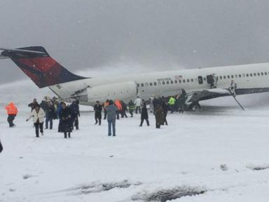 PHOTO: A photo posted to Twitter shows passengers disembarking from a Delta plane the slid off the runway at Laguardia Airport in New York, March 5, 2015.