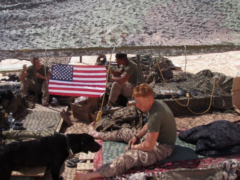 PHOTO: Marine Sgt. Mark Slocum and his dog Tug are pictured here in Afghanistan during Slocums deployment in 2011.