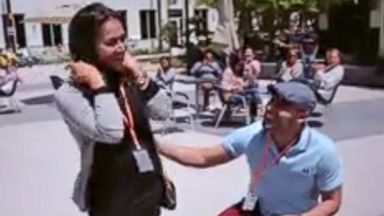 PHOTO: Nafis Joon reacts as Steve Kawalit makes a surprise proposal at the Facebook headquarters in Menlo Park, California, on June 23, 2014.
