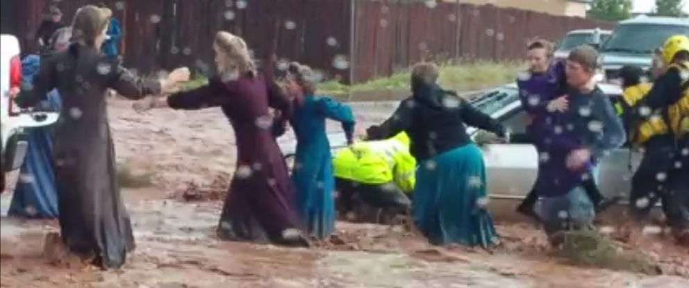 PHOTO: Video shows a group of people escaping a car with the help of emergency personnel during a flash flood in Hildale, Utah, Sept. 15, 2015.