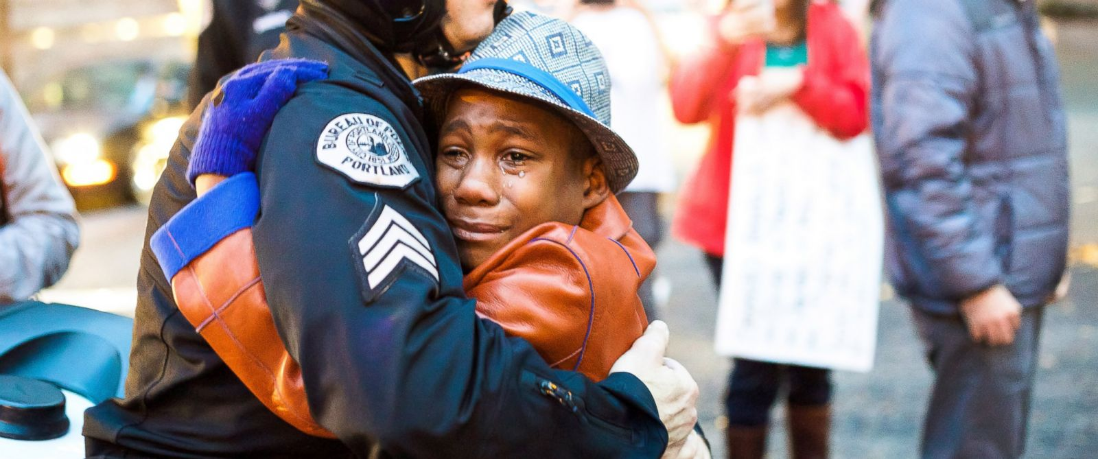 PHOTO: Police Sgt. Bret Barnum hugs 12-year-old Devonte Hart during a demonstration in Portland, Ore. calling for police reform after the Ferguson grand jury decision on Nov. 25, 2014.