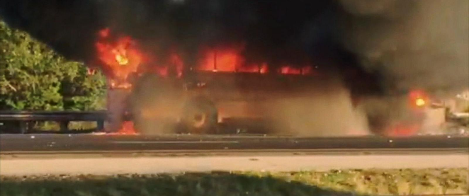 PHOTO: A school bus driver helped students to safety in Florida after the bus was engulfed by flames, Dec. 3, 2014.