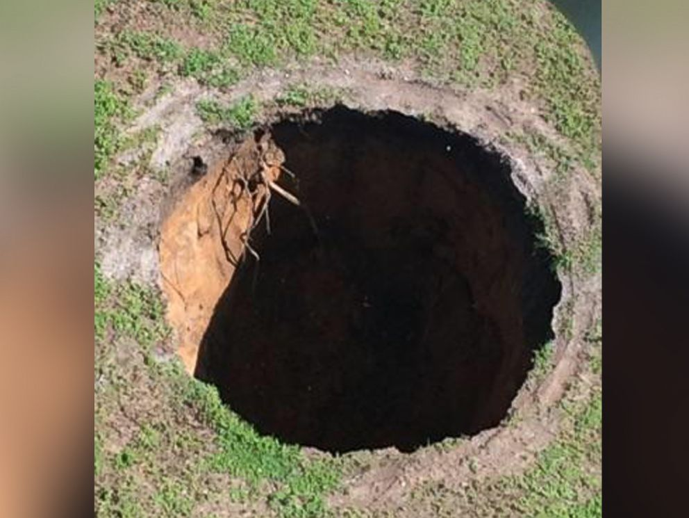 PHOTO: The sinkhole that killed Jeffrey Bush in 2013 re-opened on Aug. 19, 2015 in Seffner, Fla.