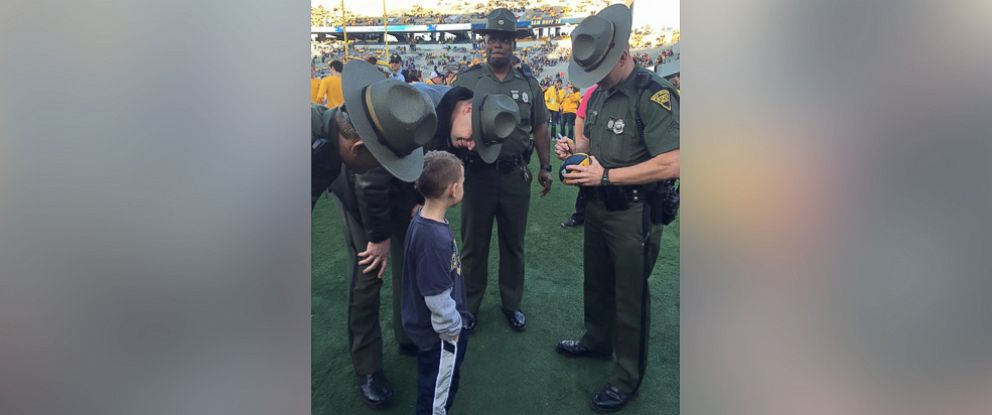 PHOTO:At a West Virginia University football game Saturday, 6-year-old Braedon Mullins asked state troopers to autograph his football instead of the football players.
