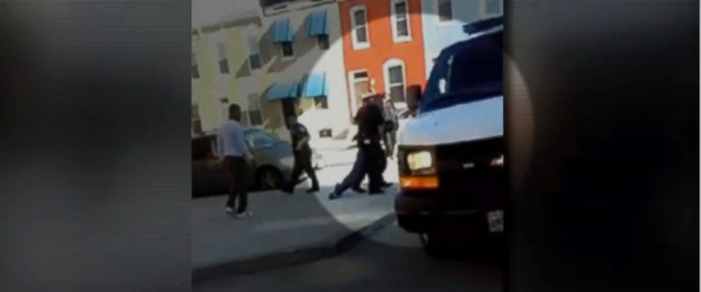 PHOTO: Cell phone video captures officers dragging Freddie Gray, 25, into a police van in Baltimore.