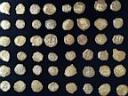 PHOTO: A florida company, 1715 Queens Fleet Jewels, found 48 coins off the coast of Sebastian coast, estimated to cost $250k that they are sending to private investors.