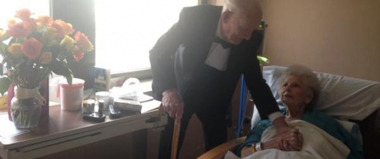 "PHOTO: On their 57th anniversary, James ""Jim"" Russell showed up to his wife Elinors hospital room wearing a tuxedo and carrying flowers and chocolate."