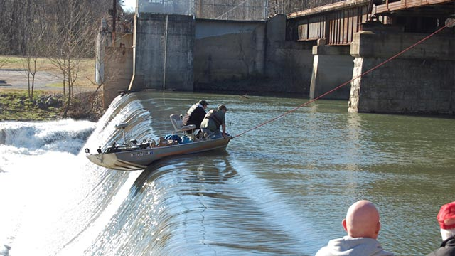 PHOTO: Boat dangling over dam