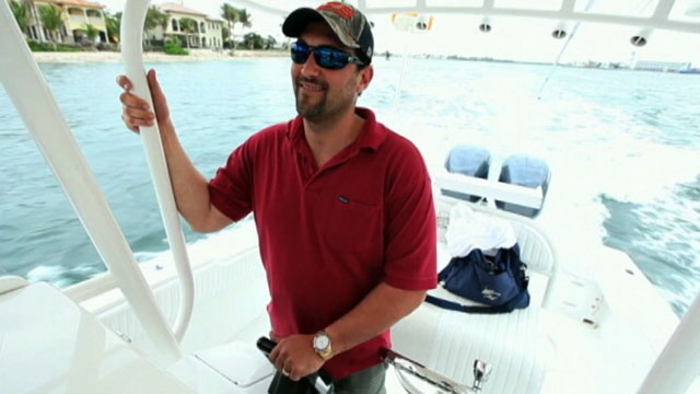 PHOTO: Guma Aguiar of Fort Lauderdale, Fla., steering his fishing boat the T.T. Zion in March 2011.