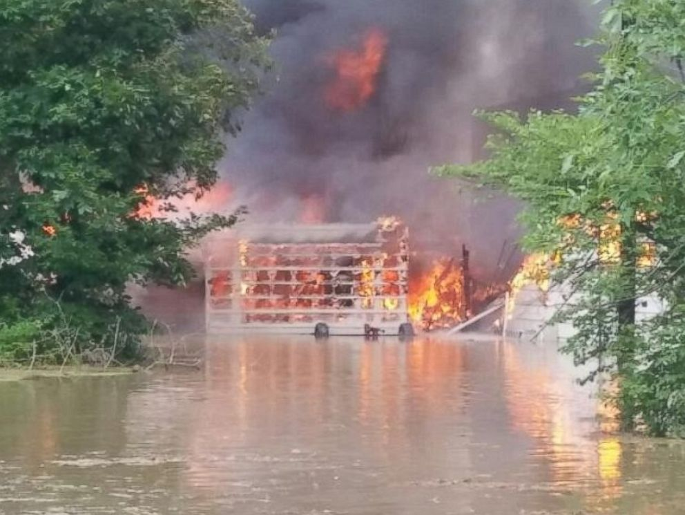 PHOTO: A flooded home caught on fire in Hartford City, Ind.