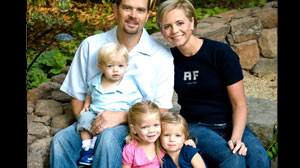 PHOTO Dr. Erin Jacobson, 37, and his wife, Amy, 35, are shown in this file photo with their children, left, Jude, 2, Taylor, 4, center, and Ava, 3. All five were killed in the plane that crashed in Montana Sunday.