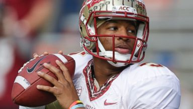 PHOTO: In this Nov. 30, 2013, file photo, Florida State quarterback Jameis Winston warms up before an NCAA college football game against Florida in Gainesville, Fla.