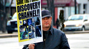 PHOTO Alleged Discovery Channel gunman James Lee protests on Georgia Avenue in front of The Discovery Channel in this February 14, 2008 file photo.