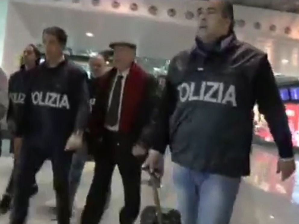 PHOTO: Italian police are shown escorting John Grillo in a video released on YouTube titled operation underboss, after arresting him in a Milan airport.
