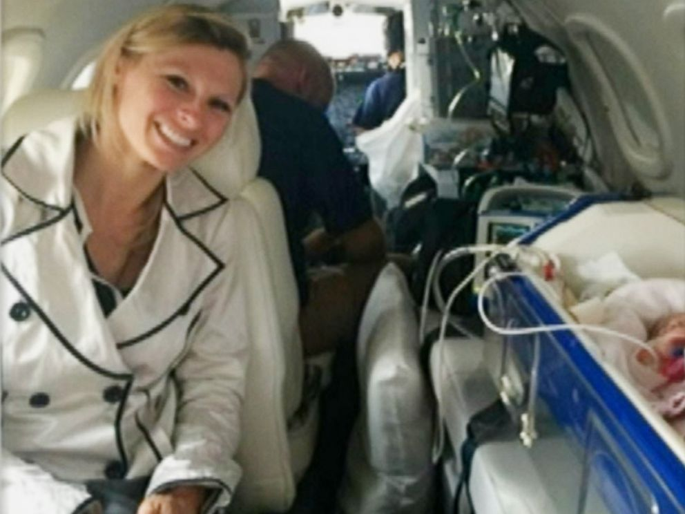 PHOTO: Kim Spratt is pictured during the flight home with her family, months after the premature birth of her daughter in Portugal.