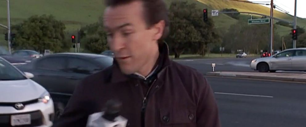 PHOTO: KTVU reporter Alex Savidge was nearly struck by a car while reporting live in Alameda County, Calif. on March 8, 2016.