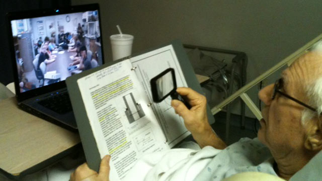 PHOTO: Professor William Kielhorn achieved 45 years of perfect attendance by not missing a single class by giving his last lecture via teleconference from his hospital bed.