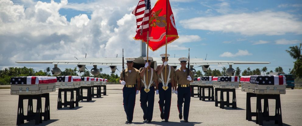 PHOTO: A 3rd Marine Regiment color guard takes its place, during a repatriation ceremony, on July 25, 2015 in Tarawa, Kiribati.