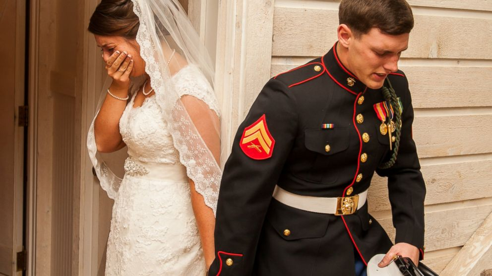 PHOTO: U.S. Marine Cpl. Caleb Earwood prays with his bride-to-be Maggie before their wedding service on Saturday in Asheville, North Carolina.