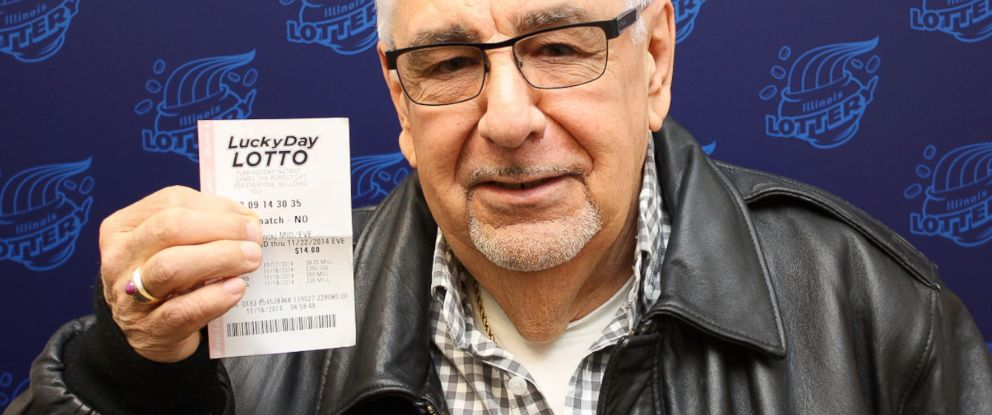 PHOTO: Martin Fuentes holds his $200,000 winning Luck Day Lotto ticket.