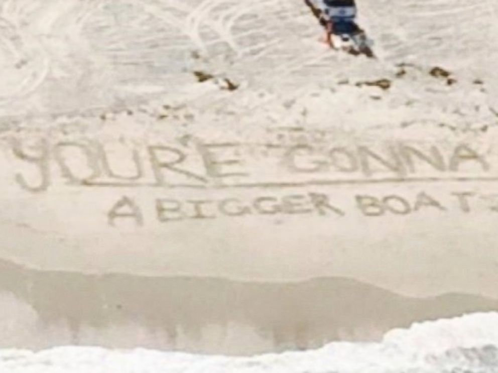 PHOTO: Beach goers left a fitting message after a shark was spotted off the coast of Duxbury Beach, Mass. on Aug. 25, 2014: Youre gonna need a bigger boat, a quote from the movie Jaws.