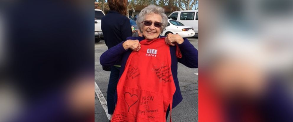 PHOTO: Mary Margaret Sims shows off the signed apron she received at her birthday party.