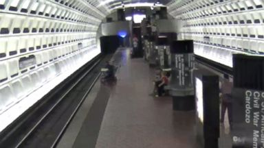 PHOTO: Surveillance footage shows a Washington man in a wheelchair fall onto the DC Metro tracks on April 21, 2015, before being rescued by other passengers.