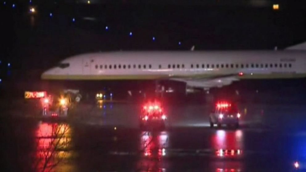 Aircraft Carrying Miami Heat Slides on Snowy Taxiway