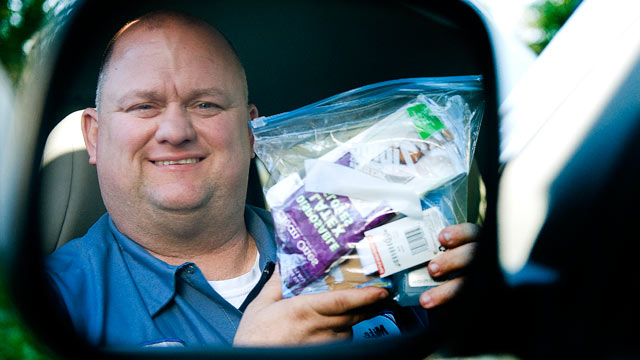 PHOTO: Mike Hawthorne of Somerdale, N.J., a truck driver who helped deliver three babies, holds a kit that he carries with him and uses while helping with child birth, April 6, 2012.