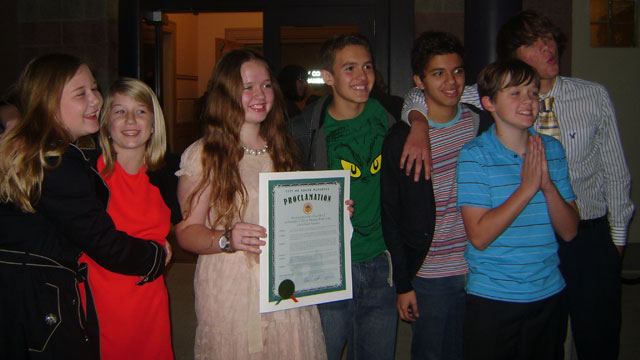 "PHOTO: Saige Hatch, 15, holding the proclamation to enforce ""Modesty Week"" in the city of South Pasadena on Dec. 5 with members of her high schools"