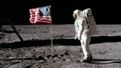 PHOTO: Buzz Aldrin stands next to a U.S. flag after it was placed on the moon.