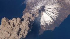 PHOTO: A photo made by a crewmember on the International Space Station shows the eruption of the Cleveland Volcano in Alaska on May 23, 2009.