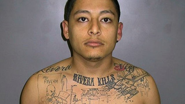 PHOTO:&nbsp;Mugshot of gang member Anthony Garcia, with a tattoo of a murder he committed on his chest, in this undated file photo.