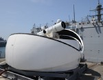 PHOTO: The Laser Weapon System (LaWS) temporarily installed aboard the guided-missile destroyer USS Dewey (DDG 105) in San Diego, Calif., July 30, 2012, is a technology demonstrator built by the Naval Sea Systems Command from commercial fiber solid state