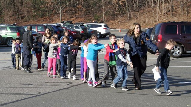 PHOTO: State police personnel led children from the school, following a shooting at Sandy Hook Elementary, Dec. 14, 2012.