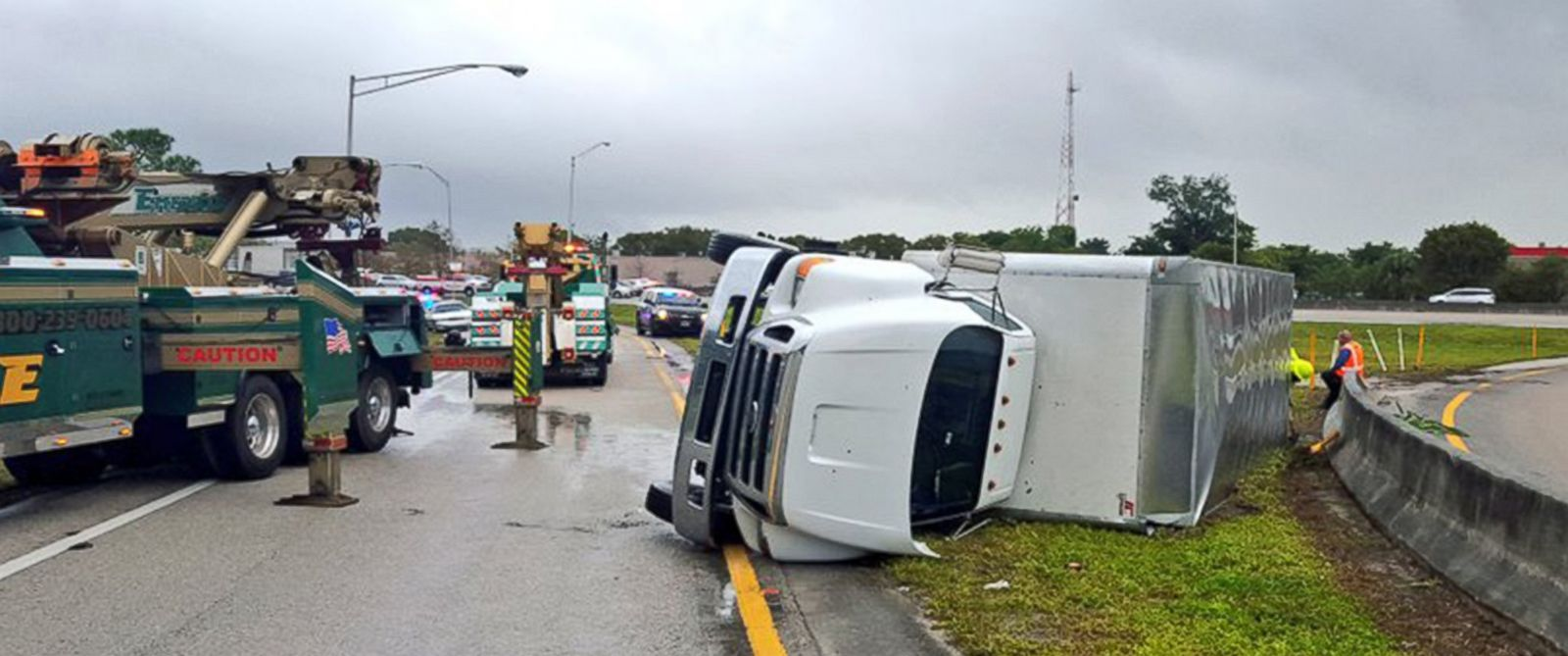 PHOTO: A tractor trailer is pictured after it was overturned by strong winds on Jan. 27, 2016, on the Florida Turnpike near the Coconut Creek Parkway in Broward County, Fla.