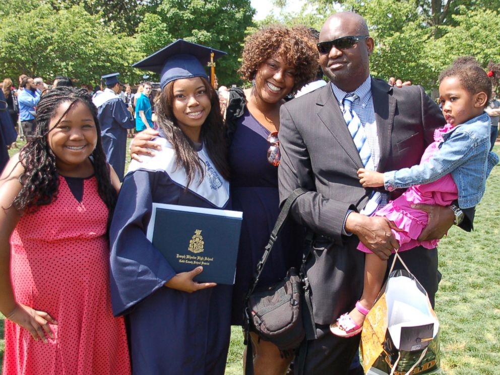 PHOTO: Melisa Alaba with her children and husband at her oldest daughter's high school graduation in May 2014.