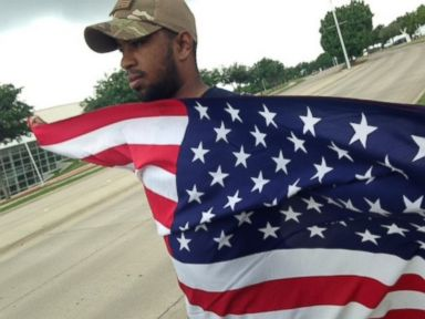 PHOTO: Joseph Offutt stood outside Culwell Center in Garland, Texas holding an American flag on Tuesday, May 5, 2015.