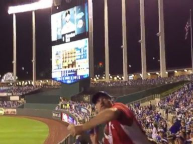 PHOTO: A peanut concession man was recorded throwing a bag of peanuts to a customer high up in the bleachers at the first game of the World Series, Oct. 21, 2014 Kansas City, Missouri.