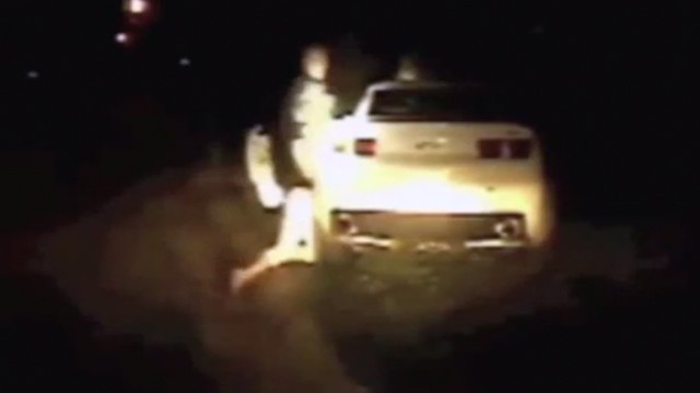 PHOTO: Police officer banging woman's head on car