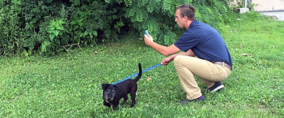 PHOTO: Muncie Animal Shelter director Phil Peckinpaugh is pictured here on a Pokemon hunt with shelter dog Winston.