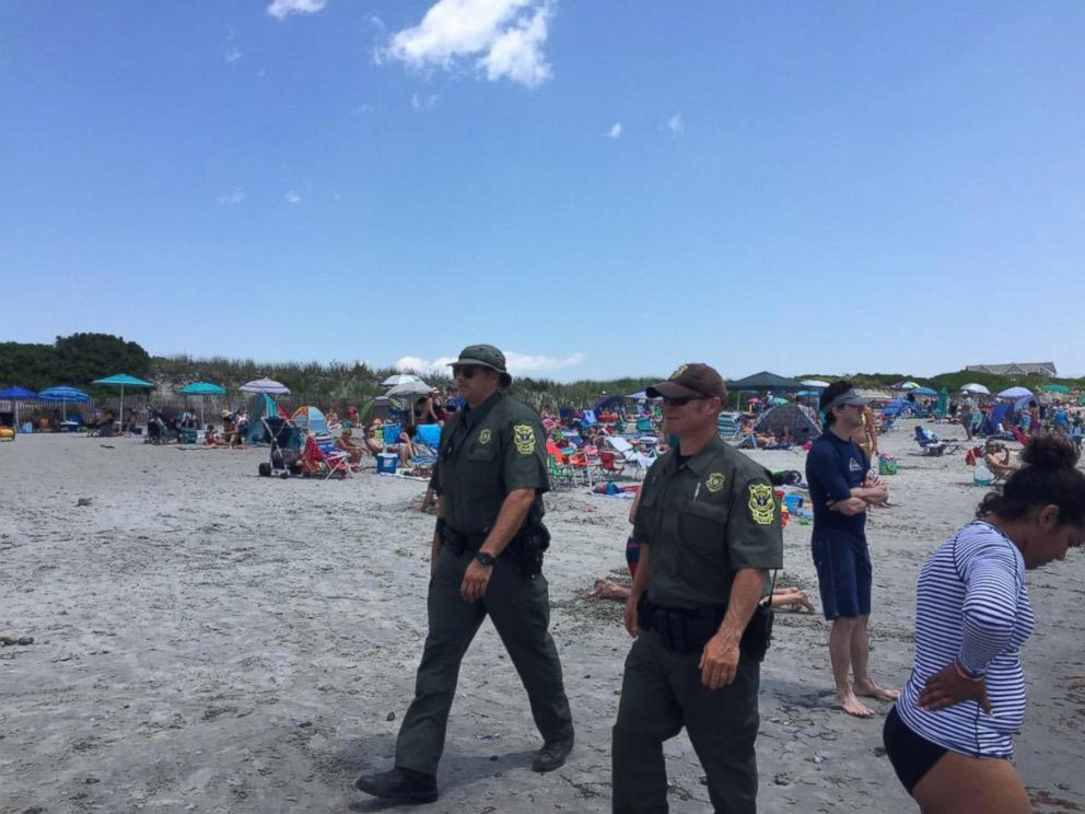 PHOTO: Officials are now patrolling Roger Wheeler Beach in Narragansett, Rhode Island after a possible explosion half a mile away at Salty Brine Beach on July 11, 2015.