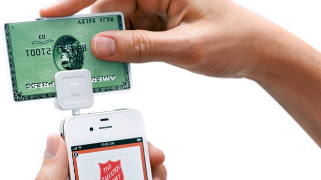 "PHOTO: Salvation Army bell ringers in select cities will be using a postage-stamp size device called ""Square,"" to accept credit card donations."